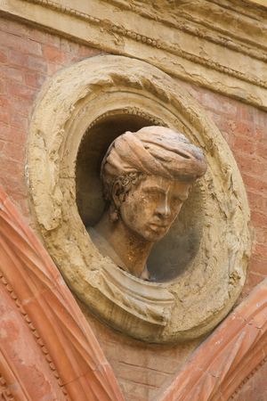 Bust at the Palazzo Bolognini Amorini Salina, a Renaissance architecture palace located on Piazza Santo Stefano in Bologna, Italy. Editorial