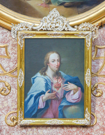 Baroque Painting of the Sacred Heart of Jesus Christ in Saint Mang Basilica in Fussen, Bavaria, Germany.