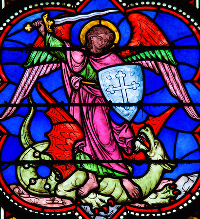 Stained glass window depicting Saint Michael the Archangel slaying Satan as a dragon, in Bayeux, Calvados, France.