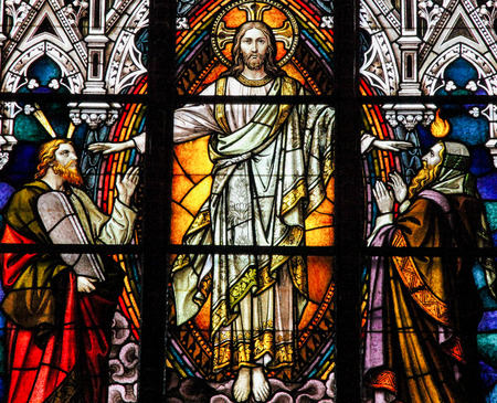 Stained glass window depicting Jesus Christ, Moses with the Ten Commandments and the Prophet Iesaiah, in the cathedral of Schwerin, Germany Stok Fotoğraf - 92855760