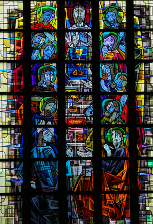 Stained glass window depicting the Last Supper in the church of Our Lady in Saint Truiden, Belgium.