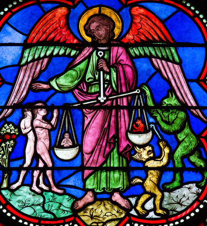 Stained glass window depicting Saint Michael the Archangel at the Final Judgement, in Bayeux, Calvados, France. 報道画像