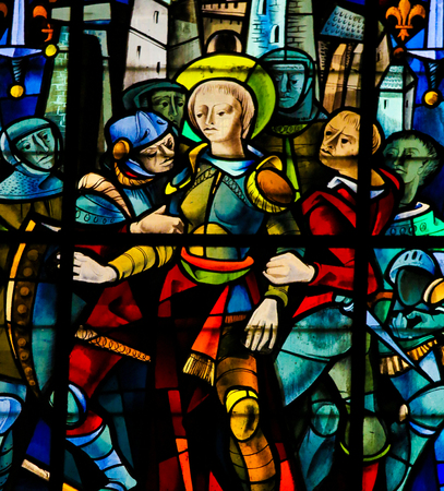 Joan of Arc captured by the Burgundians at the Siege of Compiegne (1430) on a stained glass in the cathedral of Rouen.
