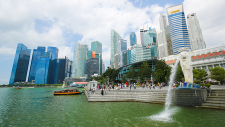 Marina Bay, Singapore - April 13, 2018: The Merlion, unofficial mascot of Singapore, half-fish and half-lion, at Marina Bay with the Singapore skyline in the background. Editorial