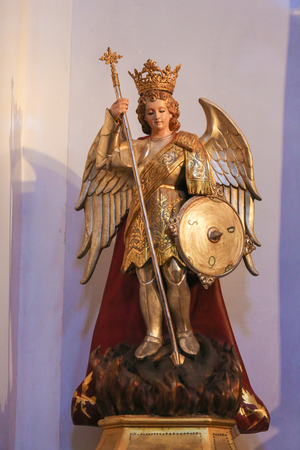 Statue of the Archangel Michael slaying Satan, in the Church of Saint Nicholas and Saint Peter Martyr in Valencia, Spain Éditoriale