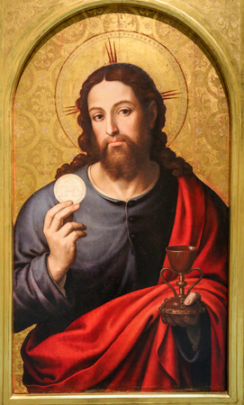 Medieval painting in a Church in Valencia, Spain, depicting Jesus Christ holding the Eucharist Redakční