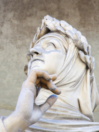 Statue of Francesco Petrarce or Petrarch in the Uffizi Colonnade in Florence, Italy. Petrarch was a famous scholar, poet and humanist.