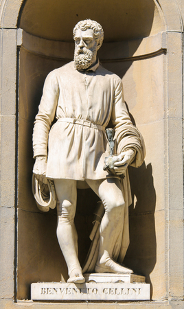 Statue of Benvenuto Cellini, a famous 16th Century Italian goldsmith, sculptor, draftsman, soldier, musician, and artist in the Uffizi Colonnade in Florence, Italy.