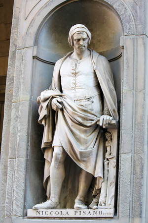 Statue of Nicola Pisano, an Italian sculptor whose work is noted for its classical Roman sculptural style, in the Uffizi Colonnade in Florence, Italy. Standard-Bild - 111725956