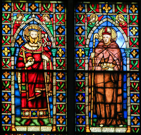 Stained Glass at the Basilica Santa Croce, Florence, Italy, depicting the French King Saint Louis and Saint Louis of Toulouse Standard-Bild - 111725967