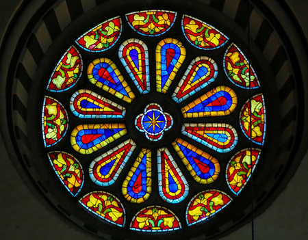 Stained Glass Round Window at the Basilica Santa Croce, Florence, Italy.