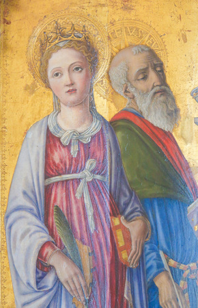 Painting in the Cathedral of Pienza, Italy, depicting Catholic Saints Standard-Bild - 111810565