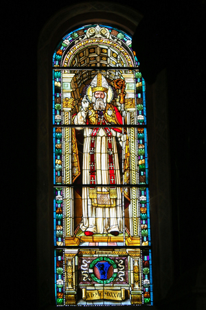 Stained Glass depicting Saint Nicholas of Bari in the Collegiata or Collegiate Church of San Gimignano, Italy. Standard-Bild - 111810664