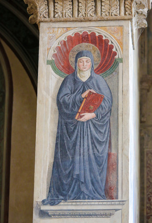 Fresco of Saint Monica in the Church of Sant Agostino in San Gimignano, Tuscany, Italy Standard-Bild - 111810666