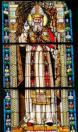 Stained Glass depicting Saint Nicholas of Bari in the Collegiata or Collegiate Church of San Gimignano, Italy. Standard-Bild - 111810672