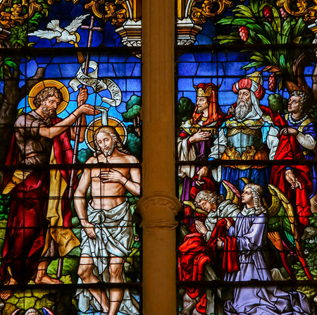 Stained glass window depicting the Baptism of Jesus by Saint John in the cathedral of Burgos, Castille, Spain.
