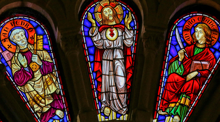 Stained glass window depicting Saint Peter, Jesus Christ and Saint John the Evangelist in the church of Viana do Castelo, Portugal.