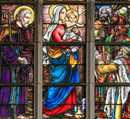 Stained Glass depicting the Three Kings visiting the infant Jesus in the Church of Haacht, Belgium. Editorial