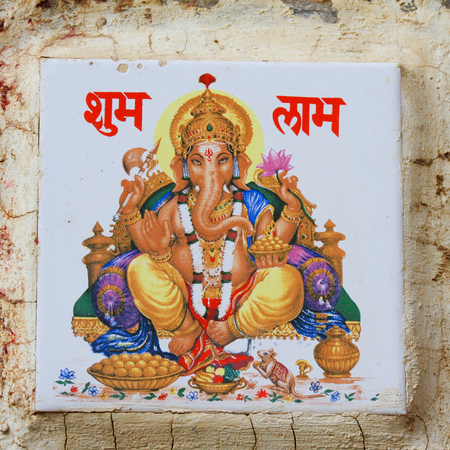Small painting of the famous Hindy deity Ganesha on an exterior wall in Jaisalmer, Rajasthan, India.