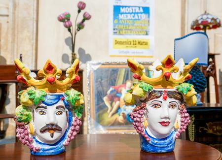 Typical handmade ceramic at a flea market in Martina Franca, Taranto province, South Italy. Standard-Bild - 111811274