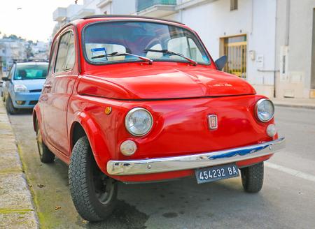 The iconic Fiat 500 (1970 design) on a street in Alberobello, small town of the Metropolitan City of Bari, Puglia, Southern Italy.