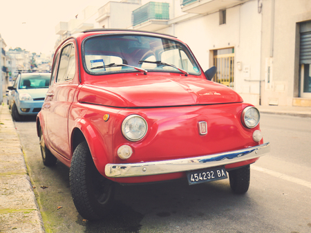 The iconic Fiat 500 (1970 design) on a street in Alberobello, small town of the Metropolitan City of Bari, Puglia, Southern Italy. Standard-Bild - 111811279