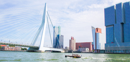 View on the city center and the Erasmus Bridge in Rotterdam, South Holland, The Netherlands. Standard-Bild - 111812636