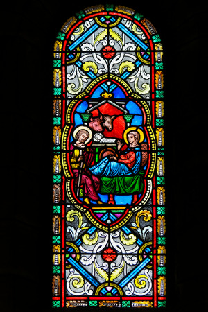 Stained Glass in the Cathedral of Monaco depicting a Nativity Scene at Christmas