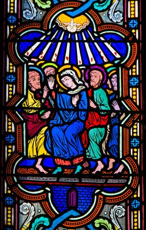 Stained Glass in the Cathedral of Monaco depicting Mary and the Apostles at Pentecost Stockfoto - 119630849