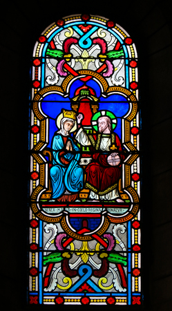Stained Glass in the Cathedral of Monaco depicting the Coronation of Mother Mary by Jesus Christ in Heaven