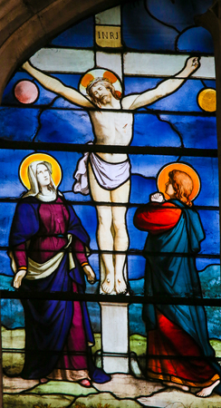 Stained Glass in the Church of Saint Severin, Latin Quarter, Paris, France, depicting Jesus Christ on the Cross, with Mother Mary and Saint John