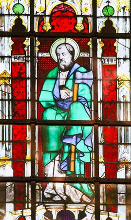 Stained Glass in the Church of Saint Severin, Latin Quarter, Paris, France, depicting Saint Matthias holding an Axe Stock fotó