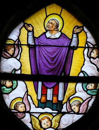 Stained Glass in the Church of Saint Severin, Latin Quarter, Paris, France, depicting Saint Vincent de Paul in Heaven