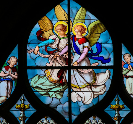Stained Glass in the Church of Saint Severin, Latin Quarter, Paris, France, depicting Angels Editorial