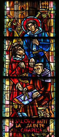 Stained Glass in the Basilica Sacre Coeur in Paris, depicting King Saint Louis of France building the Sainte-Chapelle