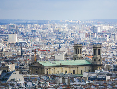 Aerial view on the center of Paris as seen from Montmartre, with the Church of St Vincent de Paul, in the 10th arrondissement of Paris.