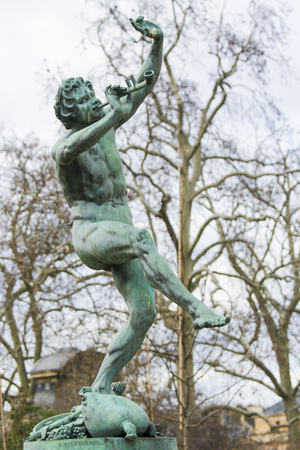 Bronze Statue of a Dancing Faun in the Jardin de Luxembourg, Paris, France