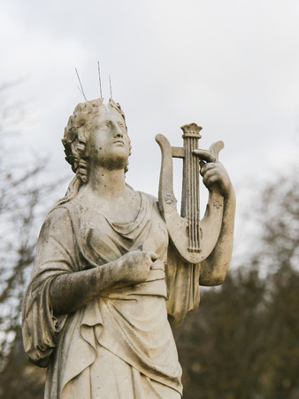 Statue of Calliope, in Greek Mythology the muse who presides over eloquence and epic poetry, holding a lyre in the Jardin de Luxembourg, Paris, France