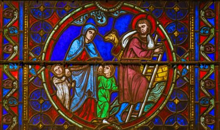 Stained Glass in the Cathedral of Notre Dame, Paris, France, depicting St Eustace, a christian martyr, his wife Theopista and their sons Agapius and Theopistus