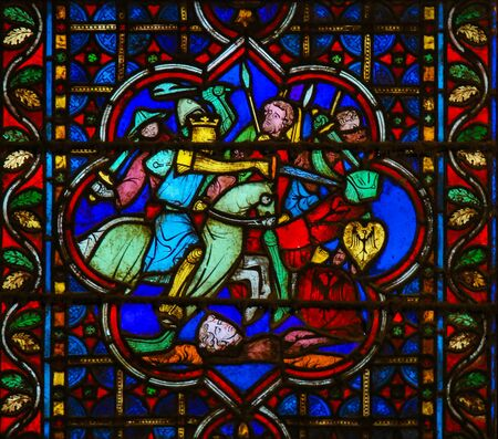 Stained Glass in the Cathedral of Notre Dame, Paris, France, depicting Medieval Knights in Battle