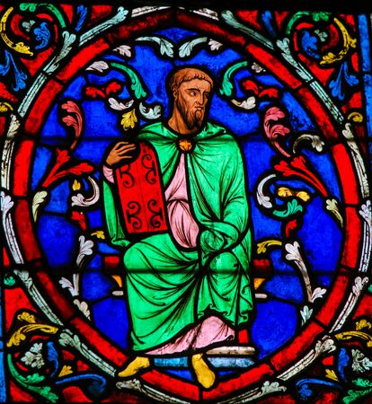 Stained Glass in the Cathedral of Notre Dame, Paris, France, depicting Moses carrying the Stone Tablets with the Ten Commandments