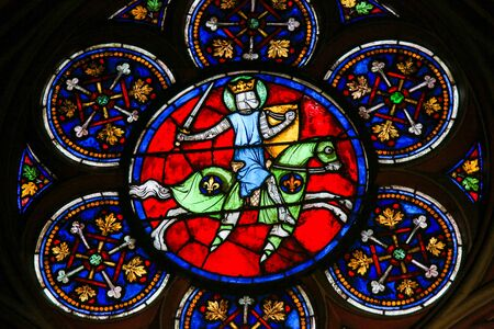 Stained Glass in the Cathedral of Notre Dame, Paris, France, depicting a Medieval Knight on Horseback
