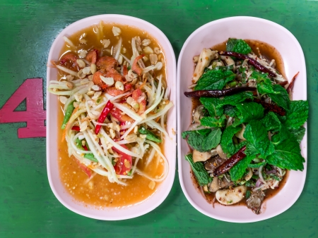 tam: Thai food Narm Tok and Som tam thai  green papaya salad  on green table