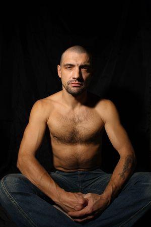 40 year old: Man sitting and meditation
