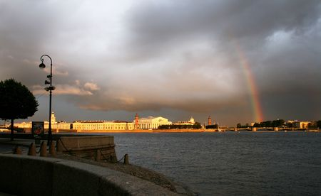 Storm clouds and rainbow over river in the city Stock Photo - 2215083