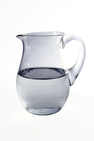 Jug with water on white background photo