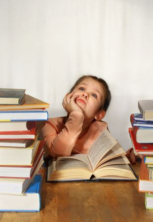 inattentive: The little girl dream, many books on table near she