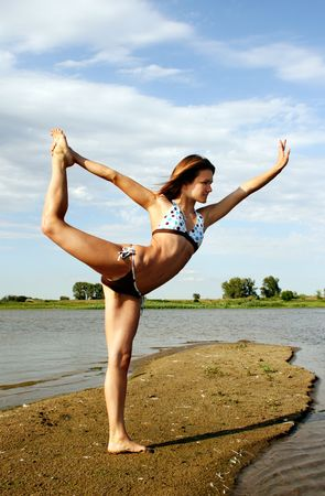 Young woman exercising on beach photo