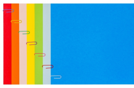 Rainbow Stationery with Paper-Clips presented Horizontally. Stock Photo