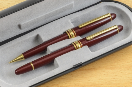 Fountain Pen and Pencil Set laidout in their Box. photo